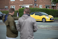 © Licensed to London News Pictures . 15/08/2015 . Manchester , UK . The scene on Lightbowne Road , Moston in Manchester where a man died following a fatal road accident in the early hours of this morning (Saturday 15th August 2015) . Police report a green Rover 25 collided with a lamppost and a passenger , believed to be 21 years old , was pronounced dead at the scene . An 18 year old passenger is in hospital with life-threatening injuries and the 19 year old driver is also in hospital , in a serious but stable condition . Photo credit : Joel Goodman/LNP