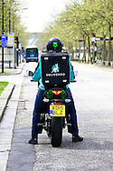 Tristan Harding, Deliveroo Motorcyclist sets off on a delivery down one Milton Keynes large boulevards
