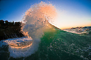 Spectacular foamy wave photographed just as the sun set