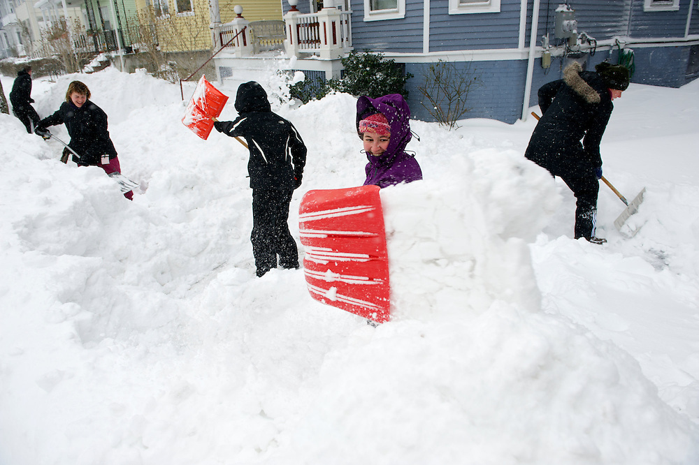 """(20130209, Somerville, Massachusetts)-..Mary Patterson shovels snow during Winter Storm Nemo in Somerville, Massachusetts on Saturday, Feb. 9, 2013.  """"I actually love the camaraderie of snow shoveling,"""" said Patterson...Photo by Brooks Canaday/The Weather Channel"""