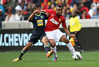 Manchester United's Anderson against Ajax Cape Town's Nazeer Allie during their International friendly match at Cape Town Stadium