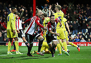 Brentford midfielder Sergi Canos celebrating scoring Brentfords first goal during the Sky Bet Championship match between Brentford and Nottingham Forest at Griffin Park, London, England on 21 November 2015. Photo by Matthew Redman.