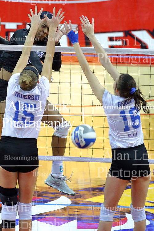 23 November 2017:  Damadj Johnson slams the ball past blockers Kyla Inderski and Gillian Gergen during a college women's volleyball match between the Drake Bulldogs and the Indiana State Sycamores in the Missouri Valley Conference Tournament at Redbird Arena in Normal IL (Photo by Alan Look)