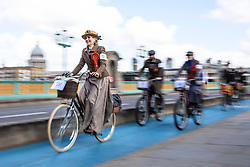 © Licensed to London News Pictures. 04/05/2019. London, UK. Riders cycle across Southwark Bridge on the Tweed Run bike ride in London. The annual event sees hundreds of people cycle around the capital past various landmarks wearing vintage tweed outfits. Photo credit: Rob Pinney/LNP