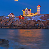 Full moon rise across the iconic Nubble Lighthouse with its Holidays Decoration taken at sunset in York, Maine. Loved watching this sunset burst into colors and capturing the Christmas Lights while the last light of the day created a beautiful sky across one of Maine's most iconic Christmas light scenes.<br /> <br /> Maine moonrise Cape Neddick Light fine art photography is available as museum quality photography prints, canvas prints, acrylic prints or metal prints. Prints may be framed and matted to the individual liking and room decor needs:<br /> <br /> https://juergen-roth.pixels.com/featured/full-moon-over-nubble-lighthouse-juergen-roth.html<br /> <br /> My best,<br /> <br /> Juergen<br /> Prints: http://www.rothgalleries.com<br /> Photo Blog: http://whereintheworldisjuergen.blogspot.com<br /> Instagram: https://www.instagram.com/rothgalleries<br /> Twitter: https://twitter.com/naturefineart<br /> Facebook: https://www.facebook.com/naturefineart