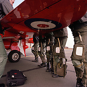 Pilots of the Red Arrows, Britain's RAF aerobatic team during pre-display briefing on a Hawk wing before a training sortie.