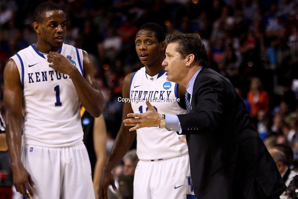 Mar 19, 2011; Tampa, FL, USA; Kentucky Wildcats head coach John Calipari talks to his player during the second half of the third round of the 2011 NCAA men's basketball tournament against the West Virginia Mountaineers at the St. Pete Times Forum. Kentucky defeated West Virginia 71-64.  Mandatory Credit: Derick E. Hingle