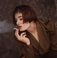 Beautiful woman smoking - Photograph by Owen Franken