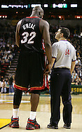 Miami Heat' Shaquille O'Neil chats with a referee during a break in the game against the Seattle SuperSonics in Seattle. (AP Photo/John Froschauer).