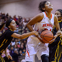 Gallup Bengal Ni'Asia McIntosh (34) is fouled by the Tohatchi Cougars as she drives to the hoop Thursday at Gallup High School.