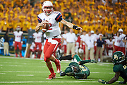 WACO, TX - SEPTEMBER 2:  Stephen Calvert #12 of the Liberty Flames scrambles against the Baylor Bears during a football game at McLane Stadium on September 2, 2017 in Waco, Texas.  (Photo by Cooper Neill/Getty Images) *** Local Caption *** Stephen Calvert