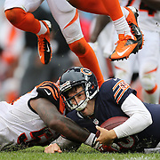 Chicago Bears quarterback Jay Cutler (6) is hit by Cincinnati Bengals outside linebacker Vontaze Burfict (55) as he slides on a run in the fourth quarter Sunday, Sept. 8, 2013 at Soldier Field. (Brian Cassella/Chicago Tribune) B583081398Z.1 <br /> ....OUTSIDE TRIBUNE CO.- NO MAGS,  NO SALES, NO INTERNET, NO TV, CHICAGO OUT, NO DIGITAL MANIPULATION...