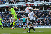 Players challenge for the ball from a corner-kick  during the Sky Bet Championship match between Derby County and Huddersfield Town at the iPro Stadium, Derby, England on 5 March 2016. Photo by Aaron Lupton.
