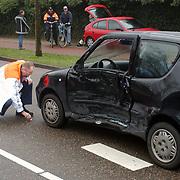 Ongeval met beknelling Naarderstraat Huizen