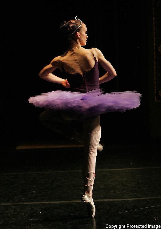 "A young dancers twirls during the ""Dance of the Sugar Plums"", a ballet segment of the Nutcracker Ballet performed in Des Moines, Iowa."