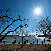A class of school children walk along the Tidal Basin waterfront in front of the famous cherry trees on a crisp winter morning. Each spring about 1,700 cherry trees around the Tidal Basin bloom in a colorful but brief floral display that brings large numbers of visitors to the region.