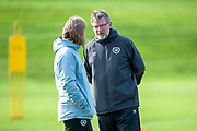 Craig Levein, manager of Heart of Midlothian, (right) talks to Austin MacPhee, assistant coach, during training ahead of the visit of Livingston FC, at Oriam Sports Performance Centre, Riccarton, Edinburgh, Scotland on 20 September 2018.