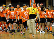 LOWER MAKEFIELD, PA - MARCH 22:  The boys orange team competes in a three legged race during Pennsbury High School's 66th annual sports nite at Charles Boehm Middle School March 22, 2014 in Lower Makefield, Pennsylvania. 11th and 12th grade students divide up into teams of black & orange (grouped by their physical education classes) and compete in a friendly rivalry through relays, skits, dances, artistic murals, cheers, and team organization. (Photo by William Thomas Cain/Cain Images)