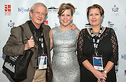 Jolene Pinder with Andy and Odette Pinder on the red carpet during opening night of the 25th Anniversary New Orleans Film Festival; Opening night film is 'Black and White' directed by Mike Binder