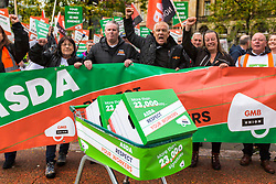 © Licensed to London News Pictures. 16/10/2019. Leeds UK. Workers at the supermarket chain ASDA have delivered over 23,000 signatures against new contracts to the ASDA head office during a protest in Leeds city centre this morning. The workers are protesting over the supermarkets attempts to change their current contracts. The new offer labelled Contract 6 will put an end to paid breaks & force staff to work for £9 an hour on bank holidays. Photo credit: Andrew McCaren/LNP