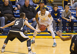 West Virginia Mountaineers guard Jevon Carter (2) looks for an open teammate against the Wofford terriers during the first half at the WVU Coliseum.