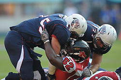 16.07.2011, Ernst Happel Stadion, Wien, AUT, American Football WM 2011, Germany (GER) vs France (FRA), im Bild Nick Rossi (USA, #75, OL, DL) und Dane Wardenburg (USA, #77, OT) vs Thaine Carter (Canada, #52, LB) // during the American Football World Championship 2011 game, Germany vs France, at Ernst Happel Stadion, Wien, 2011-07-16, EXPA Pictures © 2011, PhotoCredit: EXPA/ G. Holoubek