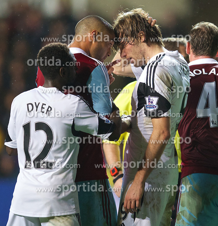 27.10.2013, Liberty Stadion, Swansea, ENG, Premier League, Swansea City vs West Ham United, 09. Runde, im Bild Swansea City's Miguel Perez Cuesta 'Michu' is accused using an elbow by West Ham United's Winston Reid // during the English Premier League 09th round match between Swansea City AFC and West Ham United at the Liberty Stadion in Swansea, Great Britain on 2013/10/27. EXPA Pictures &copy; 2013, PhotoCredit: EXPA/ Propagandaphoto/ David Rawcliffe<br /> <br /> *****ATTENTION - OUT of ENG, GBR*****