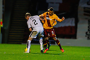 Motherwell FC Midfielder Lionel Ainsworth takes on Dundee FC Defender Gary Irvine during the Ladbrokes Scottish Premiership match between Motherwell and Dundee at Fir Park, Motherwell, Scotland on 12 December 2015. Photo by Craig McAllister.
