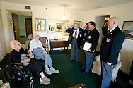 World War I Veteran Harry Landis, 107, at home in Sun City Center.  Landis is one of only four known surviving veterans of WWI.  Pictured, three retired officers from the Military Officers Association of America, Cmdr. Ed Socha, Maj. Jerry Foppe, and Lt. Col. Paul Wheat salute Landis as he sits next to his 99-year-old wife, Eleanor.