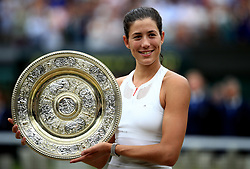 File photo dated 15-07-2017 of Garbine Muguruza with the trophy after beating Venus Williams in the Ladies Singles final at The All England Lawn Tennis and Croquet Club, Wimbledon.