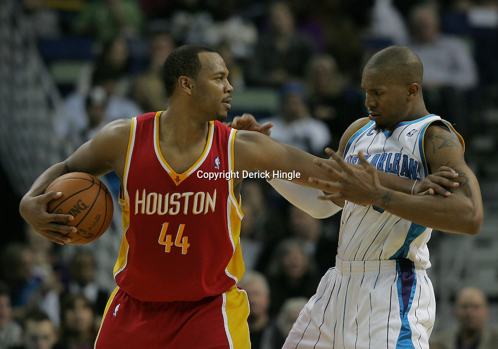 Jan 02, 2010; New Orleans, LA, USA; Houston Rockets center Chuck Hayes (44) works against New Orleans Hornets forward David West (30) during the second half at the New Orleans Arena. The Hornets defeated the Rockets 99-95.  Mandatory Credit: Derick E. Hingle-US PRESSWIRE