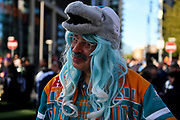 A Miami Dolphins fan wearing a blue wig and a Dolphin hat during the International Series match between Los Angeles Rams and Cincinnati Bengals at Wembley Stadium, London, England on 27 October 2019.