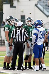 12 October 2013:  Referee Dave Wallace prepares for the coin toss.  Visible players are Kyle Pfister (44), Rob Gallik (10 and Taylor Simental (30).  NCAA division 3 football game between the North Park vikings and the Illinois Wesleyan Titans in Tucci Stadium on Wilder Field, Bloomington IL