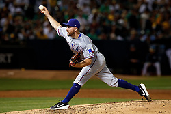 OAKLAND, CA - SEPTEMBER 21:  Adrian Sampson #52 of the Texas Rangers pitches against the Oakland Athletics during the third inning at the RingCentral Coliseum on September 21, 2019 in Oakland, California. The Oakland Athletics defeated the Texas Rangers 12-3. (Photo by Jason O. Watson/Getty Images) *** Local Caption *** Adrian Sampson