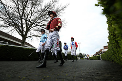 General view of jockey Luke Morris(centre)  walking into the parade ring before the Matchbook Betting Podcast Rosebery Handicap during the Easter Family Fun Day at Kempton Park Racecourse. PRESS ASSOCIATION Photo. Picture date: Saturday March 31, 2018. See PA story RACING Kempton. Photo credit should read: Steven Paston/PA Wire