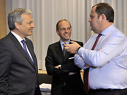 Luc Frieden, Luxembourg's minister of Finance, center, speaks with Didier Reynders, Belgium's finance minister, left, and Josef Proell, Austria's finance minister, right, during Eurogroup, the meeting of finance ministers from the sixteen countries that use the Euro as their currency,  at EU Council headquarters in Brussels, Belgium, on Monday, Nov. 9, 2009. (Photo © Jock Fistick)