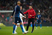 A fans invades the pitch to get close to Wayne Rooney of England during the International Friendly match between England and USA at Wembley Stadium, London, England on 15 November 2018.