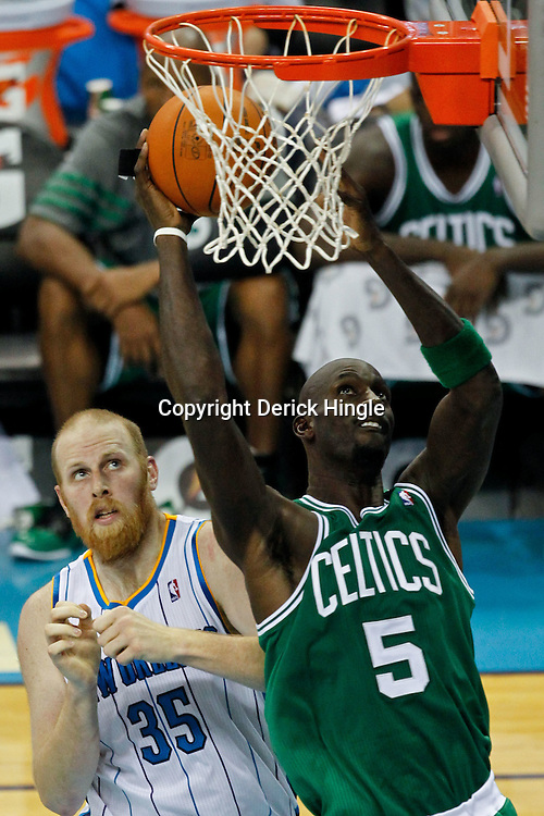 December 28, 2011; New Orleans, LA, USA; Boston Celtics power forward Kevin Garnett (5) shoots over New Orleans Hornets center Chris Kaman (35) during the second quarter of a game at the New Orleans Arena.   Mandatory Credit: Derick E. Hingle-US PRESSWIRE