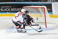 KELOWNA, CANADA - FEBRUARY 18: Jesse Lees #2 of the Kelowna Rockets shoots on the net of Deven Dubyk #33 of the Red Deer Rebels at the Kelowna Rockets on February 18, 2012 at Prospera Place in Kelowna, British Columbia, Canada (Photo by Marissa Baecker/Shoot the Breeze) *** Local Caption ***