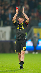 UTRECHT, THE NETHERLANDS - Thursday, September 30, 2010: Liverpool's Jamie Carragher applauds the travelling supporters after his side's poor goal-less draw against FC Utrecht during the UEFA Europa League Group K match at the Stadion Galgenwaard. (Photo by David Rawcliffe/Propaganda)