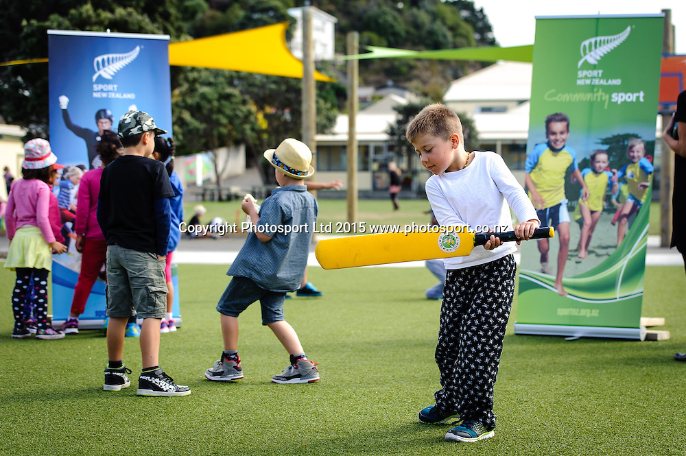 A student of Lyall Bay School plays with a cricket bat before the Sport NZ Strategy Launch, Lyall Bay School, Wellington, New Zealand. Friday 20 March 2015. Copyright Photo: Mark Tantrum/www.Photosport.co.nz