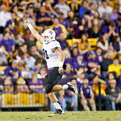 Oct 26, 2013; Baton Rouge, LA, USA; Furman Paladins offensive linesman Danny LaMontagne (60) celebrates after recovering a muffed punt during the first half of a game against the LSU Tigers at Tiger Stadium. Mandatory Credit: Derick E. Hingle-USA TODAY Sports