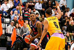 Panos Mayindombe of Bristol Flyers takes on Andre Lockhart of London Lions - Photo mandatory by-line: Robbie Stephenson/JMP - 10/04/2019 - BASKETBALL - UEL Sports Dock - London, England - London Lions v Bristol Flyers - British Basketball League Championship