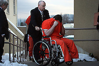 JEROME A. POLLOS/Press..Barry L. McAdoo covers his face as he is wheeled into the Kootenai County Justice Building Thursday where he was sentenced to 15 years to life in prison for the murder of his 15-month-old son.