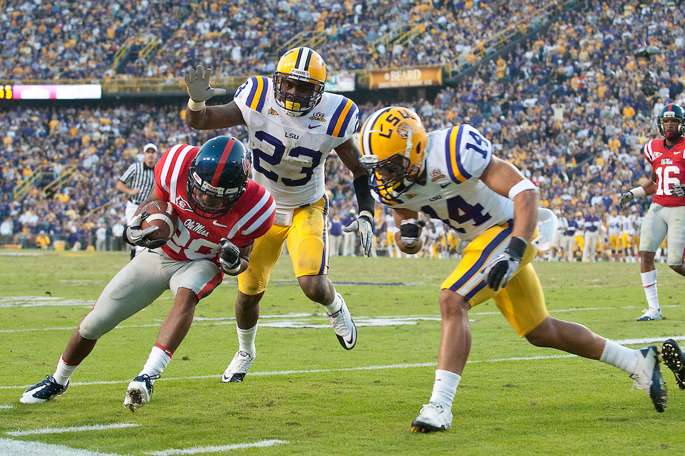 Mississippi Rebels wide receiver Brian Morris (20) runs in for yards during the second half  of the football game. LSU Tigers defeated Mississippi Rebels 43-36.