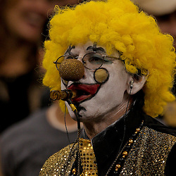 2009 September 13: New Orleans Saints fan dressed as a clown during a 45-27 win by the New Orleans Saints over the Detroit Lions at the Louisiana Superdome in New Orleans, Louisiana.