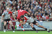 Digby Ioane is caught in the tackle of Kieran Read ~ Super 15 rugby (Round 15) - Reds v Crusaders played at Suncorp Stadium, Brisbane, Australia on Sunday 29th May 2011 ~ Photo : Steven Hight (AURA Images) / Photosport