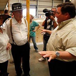 June 8, 2010; Buras, LA, USA; Plaquemines Parish President, Billy Nungesser talks with New Orleans Saints owner Tom Benson and his wife Gayle at the Tri-State Bird Center at Fort Jackosn. The entire team held a rally at Fort Jackson and visited with members of the small Plaquemines Parish fishing community of Buras that has been impacted by the oil spill. Mandatory Credit: Derick E. Hingle-US PRESSWIRE