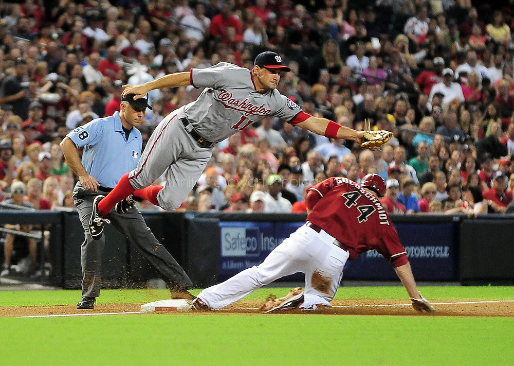 Aug. 12, 2012; Phoenix, AZ, USA; Washington Nationals infielder Ryan Zimmerman (11) attempts to catch the ball as Arizona Diamondbacks infielder Paul Goldschmidt (44) slides into third base in the second inning at Chase Field.  Mandatory Credit: Jennifer Stewart-US PRESSWIRE
