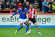 Jabo Ibehre (14) of Carlisle United battles for possession with Ryan Harley (7) of Exeter City during the EFL Sky Bet League 2 match between Exeter City and Carlisle United at St James' Park, Exeter, England on 6 May 2017. Photo by Graham Hunt.